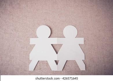 paper dolls holding hands, teamwork,community,partner,friendship concept