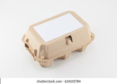 Paper egg box - egg carton on white background