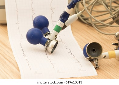 Paper with electrocardiogram in the ECG machine, selective focus with shallow depth of field.