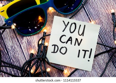 A paper with the encouraging note is present in the image In the presence of lights, glasses of different colors making look attractive You can achieve what you are trying to