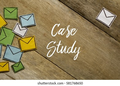 Paper envelopes and CASE STUDY written on wooden background.