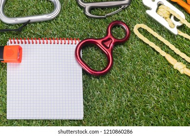 paper and expedition items on green grass