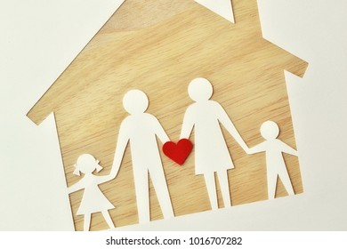 Paper family cut-out and house - Love and family union concept