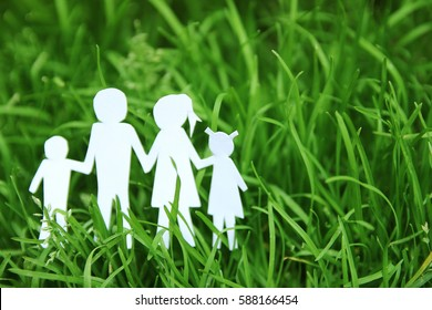 paper family on a background of grass