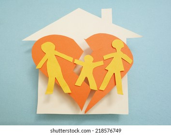 Paper family over torn heart, on house - divorce concept