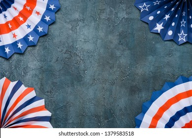 Paper fans USA flag colors on grunge background.