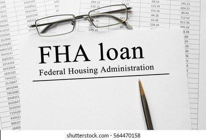Paper with FHA loan on a table