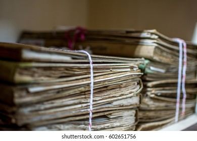 Paper files in a folder is a old documents or old letter it's a age-old and ancient archiving by stacking up in a documents paper shelf messy order