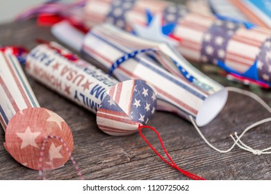 Paper firecrackers made from red, white and blue paper for July 4th celebration.