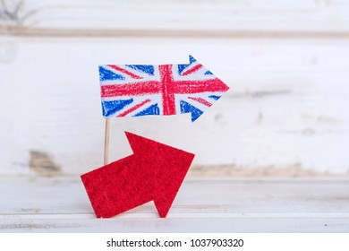 Paper Flag of the United Kingdom and red Arrow  .Brexit Concept