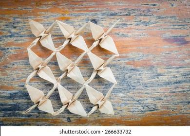 Paper flamingo bird origami in team business concept