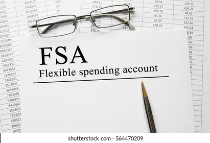 Paper with Flexible Spending Account FSA on a table - Shutterstock ID 564470209