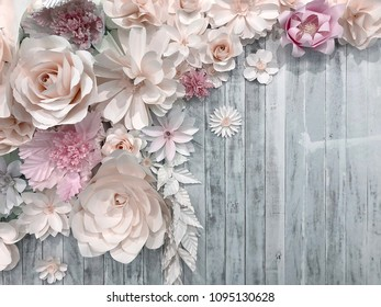 paper flower decoration on wood background. romantic decoration wedding ceremony concept with space for text