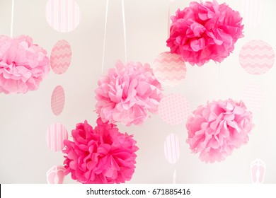 Paper flowers at the girl baby shower party. Baby shower celebration concept. Festive party background. Horizontal
