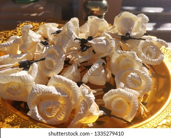 Paper flowers on the golden container for funeral ceremonies. It is the last condolence for the deceased.It is believed that the soul of the deceased is sent to a good land.