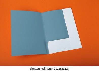 A paper folder on an orange background