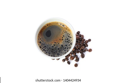 Paper glass with coffee beans isolated on white background, top view. Coffee time accessories