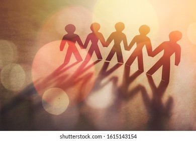 Paper group people in a Circle Holding Hands