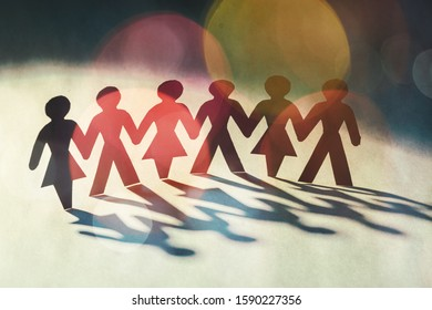 Paper group people in a semicircle holding handse background