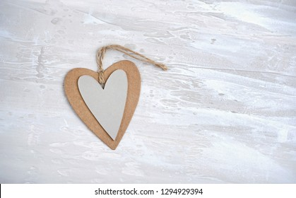 Paper heart, symbol of love on rustic background. simple style design for Valentine's day greetings. minimalism concept. valentines day concept background