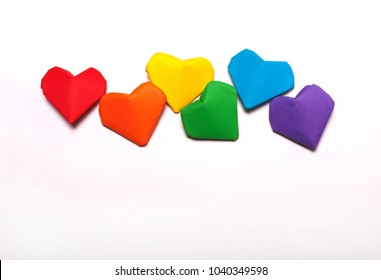 Paper hearts of a rainbow color on a white background. LGBT symbol