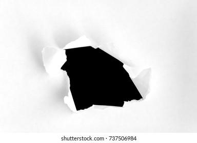 Paper hole on the black background, hole in the paper