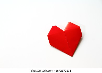 Paper homemade origami heart or love. Craft work for children
