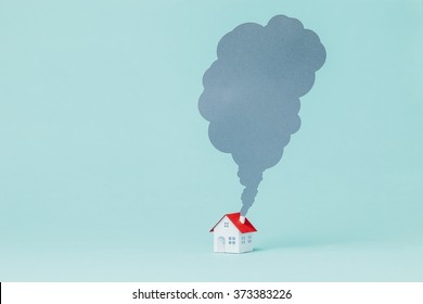 Paper house and chimney smoke.