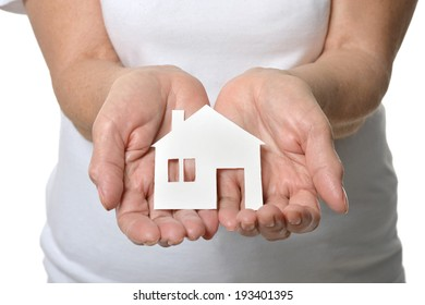 Paper house in hands of senior woman