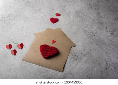 Paper house with heart flat design
