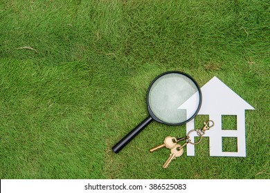 Paper house and key with Magnifying Glass, Green Living hunting, Environmental Conservation