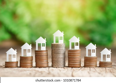 Paper house on coins stack for saving to buy a house