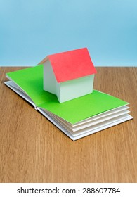 Paper house on the pages of a pop-up book