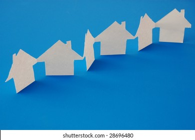 paper houses or homes showing a concept for real estate