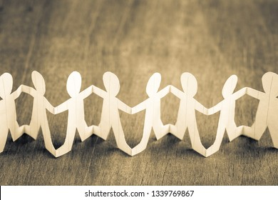 Paper human chain on wood background