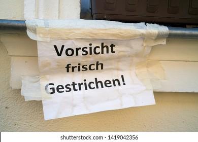 """Paper with the inscription """"Caution wet paint"""""""