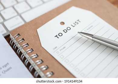 Paper with inscription to do list lying on notebook closeup. Action planning concept