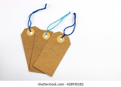 Paper Labels with Blue Threads.