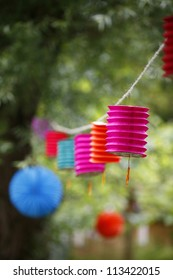 Paper lanterns hanging from a tree