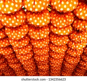 Paper lanterns of polka dots (farolillos de lunares) red and white at the April Fair in Seville, Andalusia, Spain