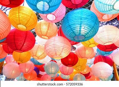 Paper lanterns strung up outside.