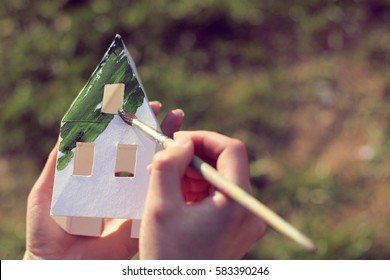 paper layout covering green house paint / concept ecological homes
