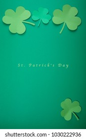 Paper leaf of clover on green background. Happy St. Patrick's Day good concept card.