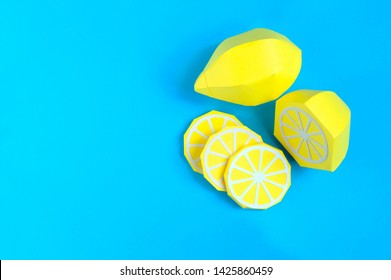 Paper lemon (whole fruit, half and slices). Paper art and craft. Trendy hobby. Minimal artistic food concept. Copy space