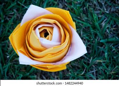 paper lotos flower grass background