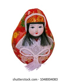 Paper mache Daruma doll in female form. Roly-poly toy - Japanese gift for success & good luck. Isolated. Selective focus.