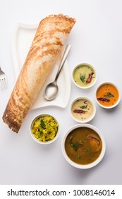 Paper Masala dosa is a South Indian meal served with sambhar and variety of coconut chutney . Selective focus
