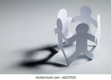 Paper men shaped into a circle.
