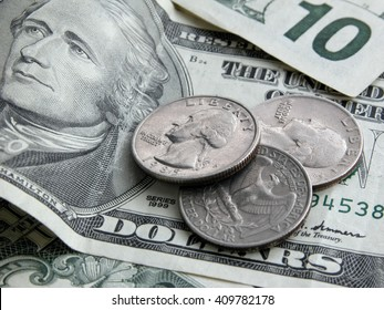 Paper money and coins - banknote, dollars, 10 dollars, cents. Coin store United States. Close-up, details, texture.
