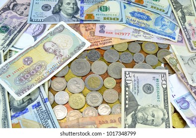 Paper money of different countries with small metal coins